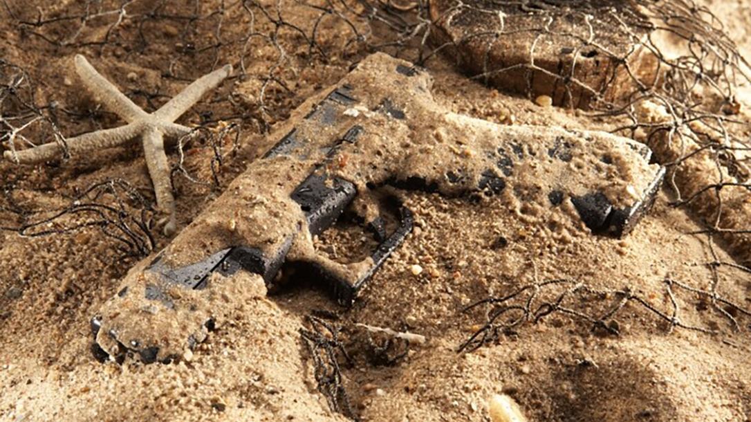 Glock 17 Pistol, Torture Test, sand