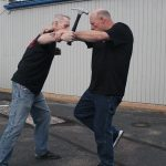 Shoulder Stop, self-defense, hammer, step 5