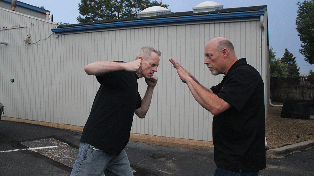 Shoulder Stop, self-defense, punch, step 2