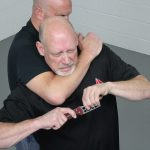 How to Escape a Chokehold, folding knife, step three