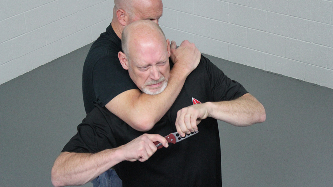 How to Escape a Chokehold, folding knife, step three