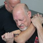 How to Escape a Chokehold, folding knife, step five