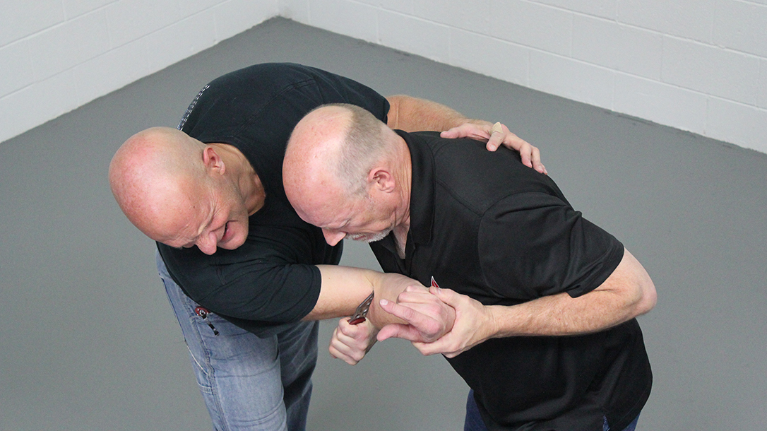 How to Escape a Chokehold, folding knife, step six