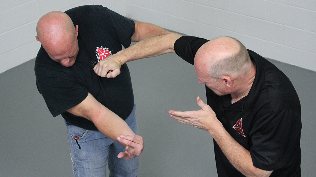 How to Escape a Chokehold, folding knife, step seven