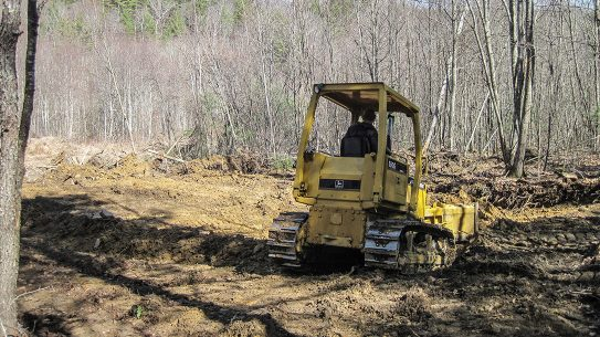 DIY Backyard Shooting Range, clearing land, bulldozer