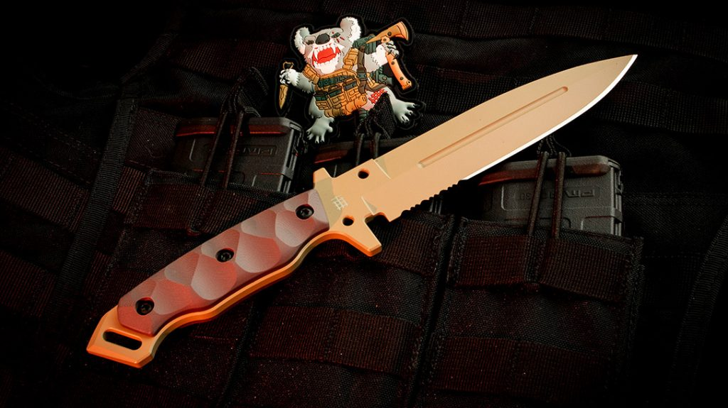 The 11.61-inch overall length of the MIK-01PS features a classic, spear point fighting knife style.