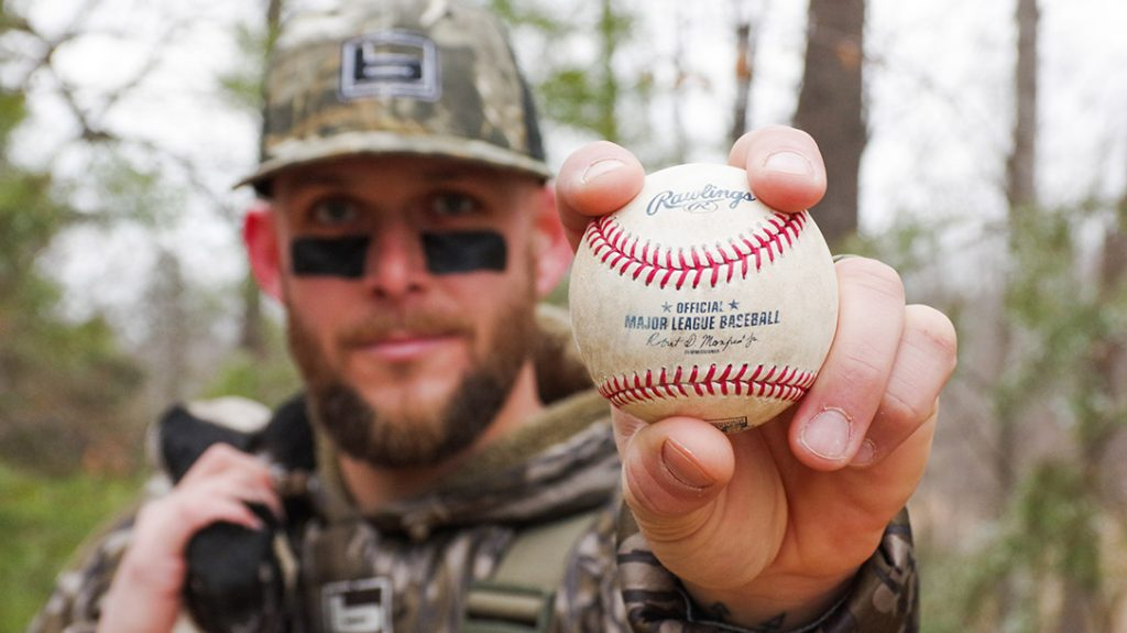Brandon Snyder with two of his favorite things, a freshly harvested duck and an official MLB ball