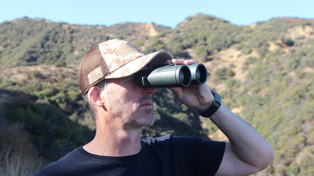 The author uses a pair of Hawke binoculars in the field.