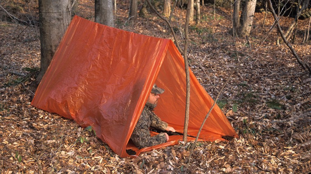 The tube tent is lightweight yet gives quick protection from inclement weather. Its orange color serves as a signal.