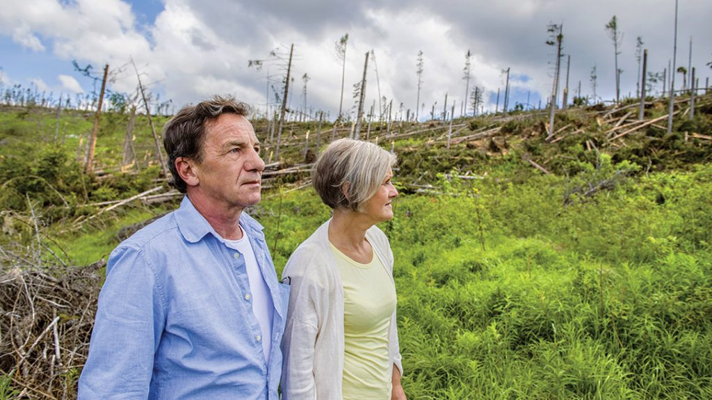A couple overlook the aftermath of a natural disaster. Ensure your and your family's survival with tips from the Mormon church.
