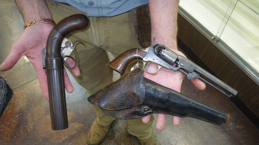"""An 1830-1840 Allen dragoon pepperbox pistol known as a """"pocket rifle,"""" and 1839 long-barreled .36-caliber Colt percussion revolver with original leather holster."""